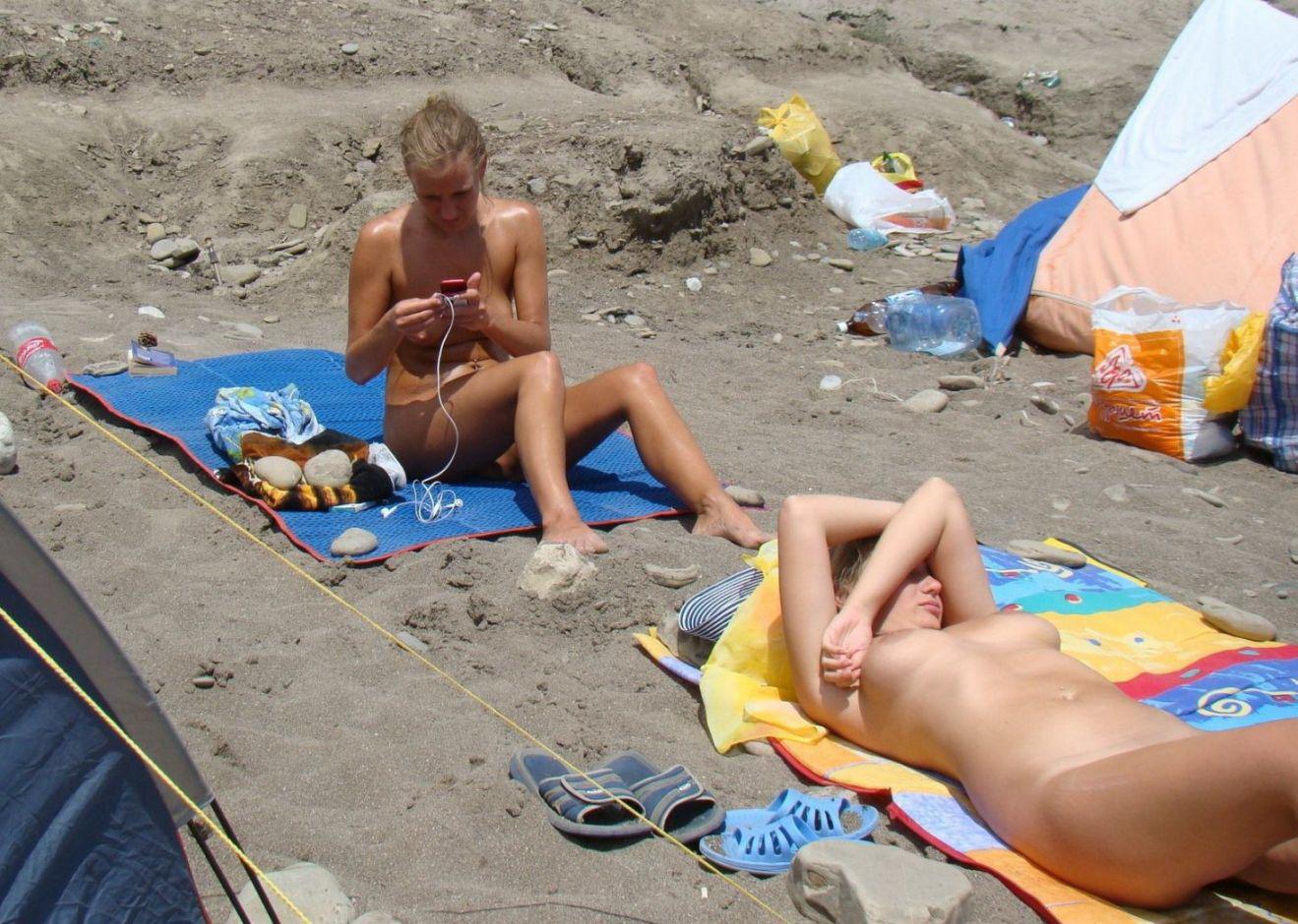 Amateur nude beach voyeur sluts enjoying the warm sun 1