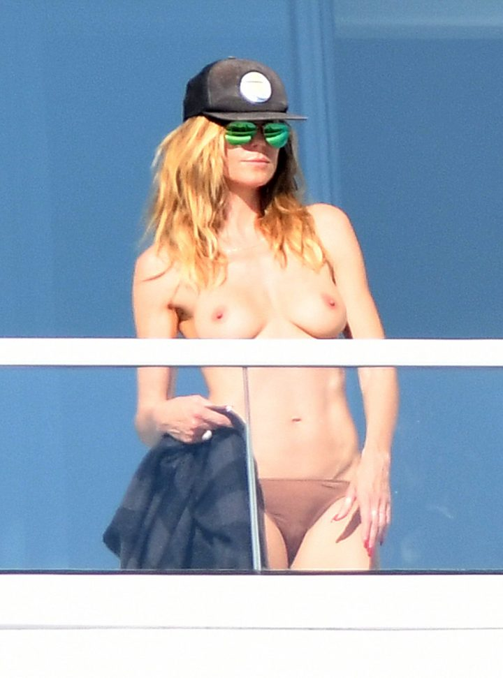 Heidi Klum sunbathes topless on a balcony in Miami