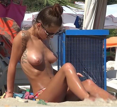 beach girl picture topless voyeur