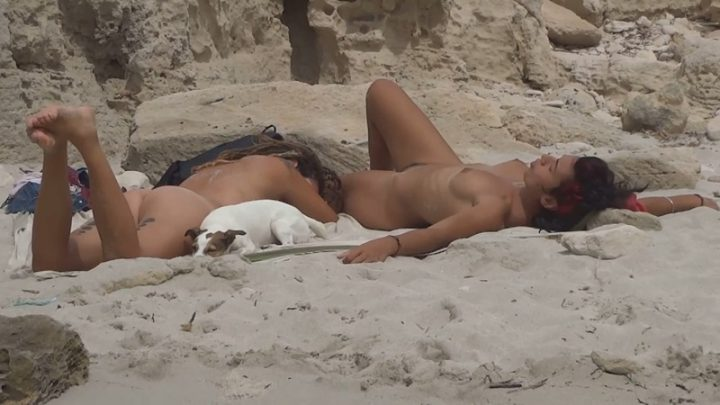 Lesbian girl relaxes on small nudist beach video